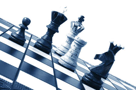 challange: chess pieces on a chess board showing concept for strategic business Stock Photo