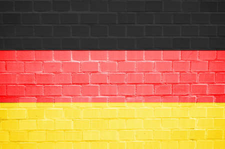 suface: flag painted on a brickwall can be used as background                            Stock Photo
