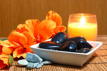 spa and wellness concept with flowers zen stones and towel Stock Photo