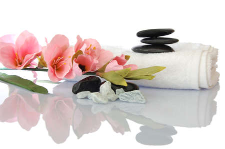wellness zen and spa still life with flower towel and pebbles isolated on white photo