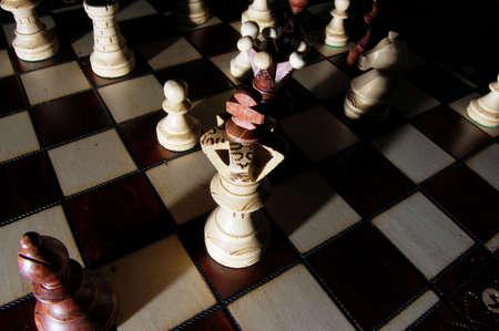 achivement: chess pieces on chess board showing power and success
