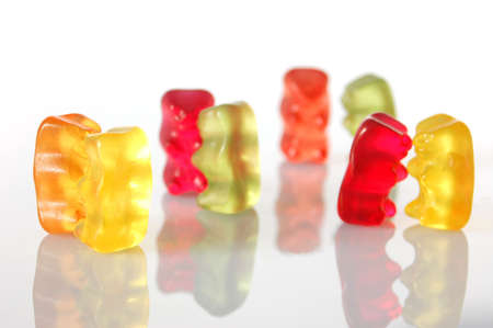 Gummy: sweet gummy bears dancing on a party on white background