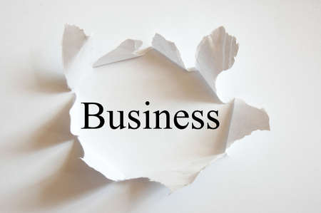 creativ: business concept with hole in white paper
