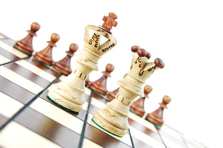 chess pieces on chess board showing concept for success and power Stock Photo - 5115598