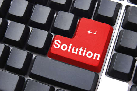 solution written on a computer keyboard enter button Stock Photo