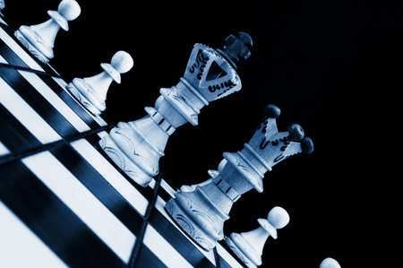 chess pieces showing concept of conflict power and success photo