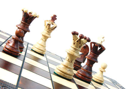 chess pieces on a chess board showing concept for strategic business photo