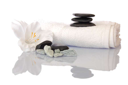 black bathroom: wellness zen and spa still life with flower towel and pebbles isolated on white