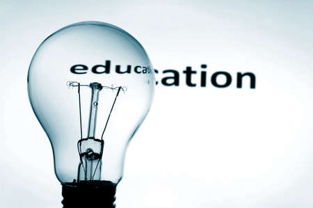 educational problem solving: bulb in blue background showing concept for education and science
