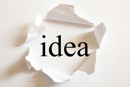 discovery: idea on white background in a paper hole