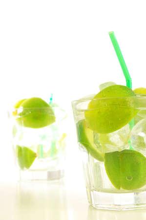 Caipirinha cocktail with lime on white background    photo