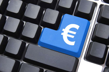 ecommerce concept with money symbol on computer button Stock Photo - 5295860