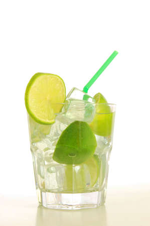 cool drink with green lime on white background                         Stock Photo