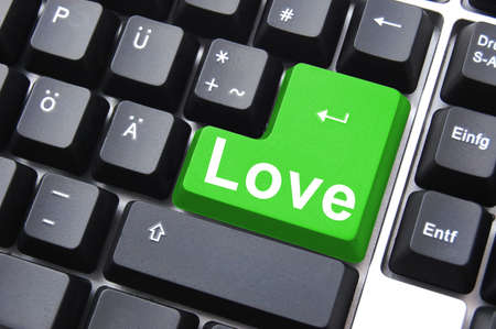 online love concept with colored button on computer keyboard photo