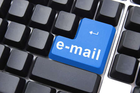 email button on computer keyboard showing concept for internet communication photo
