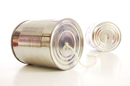 isolated tin or can telephone showing communication                                     Stock Photo - 5392146