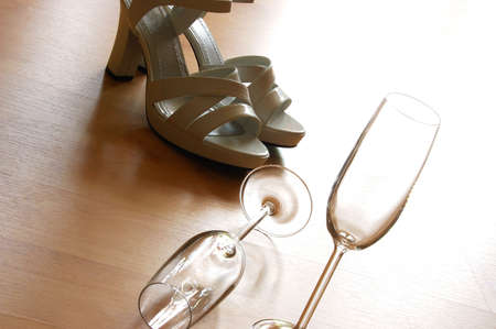 sexy high heels and champange  or sparkling wine glass photo