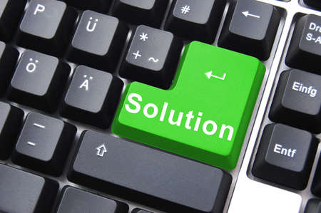 computer keyboard keys: solution written on a computer keyboard enter button Stock Photo