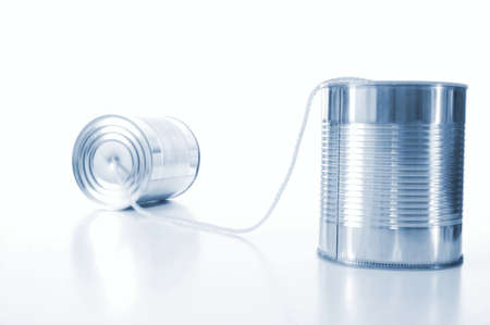 isolated tin or can telephone showing communication                                     photo