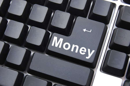 money text on computer keyboard  as concept for internet business Stock Photo - 5428681