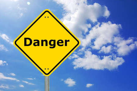 danger written on a yellow road warning sign                                     Stock Photo - 5541262
