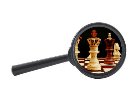 business competition concept with chess pieces and magnifying glass                                     photo