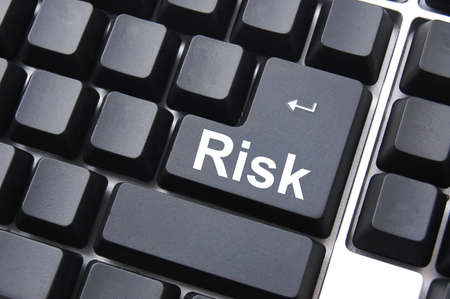 business risk management with computer keyboard enter button                                     photo