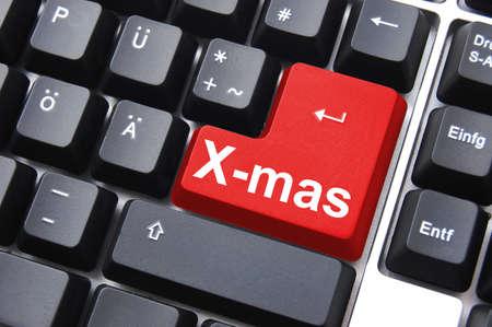 xmas or christmas holiday enter key from computer keyboard                                   photo