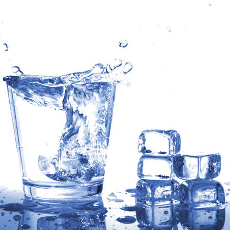 tumbler: fresh water in glass with ice cubes Stock Photo