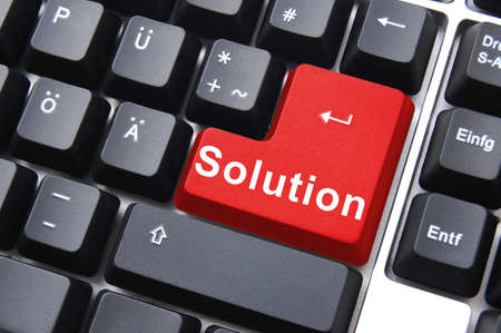 solving a problem with solution button on computer                                   photo