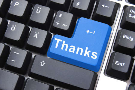 thanks written on computer button to say thank you                                     photo