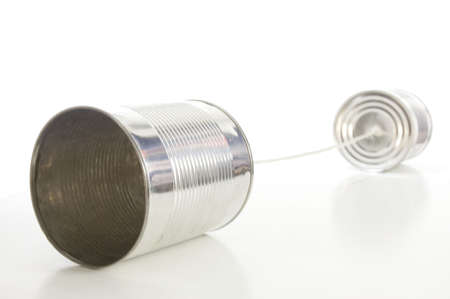 isolated tin or can telephone showing communication                                     Stock Photo - 5587714