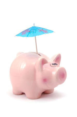 piggy bank and cocktail umbrella isolated on white background                                     photo