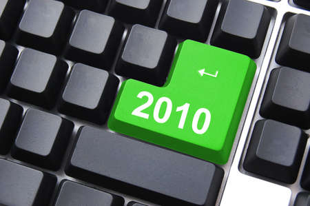 celebrate the new year 2010 with computer enter button Stock Photo - 5659086