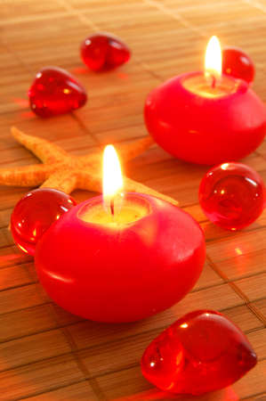romantic red candles showing spa or love concept                                  photo