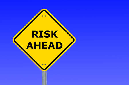 risk management concept with yellow road sign Stock Photo - 5705076