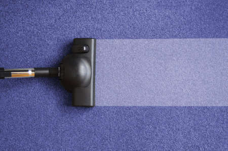 dirty carpet: vacuum cleaner on the floor showing house cleaning concept