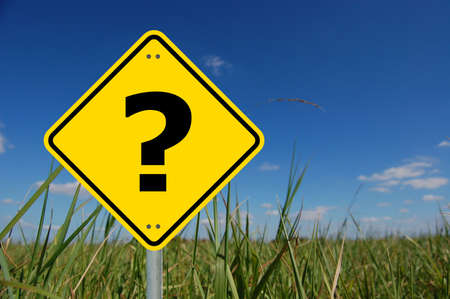 frequently asked questions: interrogation mark on yellow road sign and copyspace