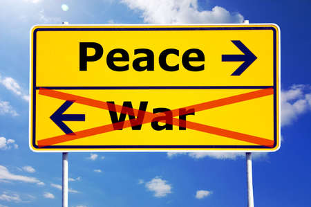world peace: peace and war concept with yellow road sign