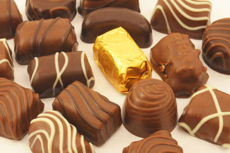 sweety brown chocolate candys are unhealthy food Stock Photo - 5737990