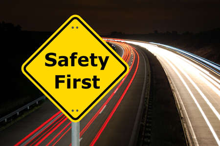 safety first: yellow sign with safety first as aid concept