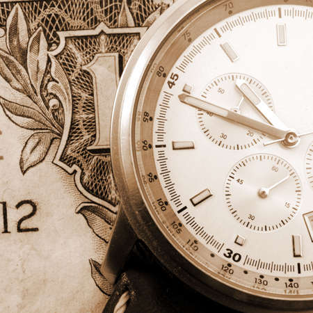 financial time concept with money and watch                                     photo