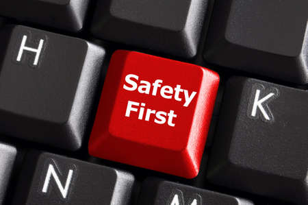 safety first concept with red key on computer keyboard Stock Photo