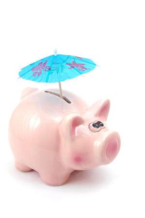lucky piggy bank and umbrella is saving business money                                  photo