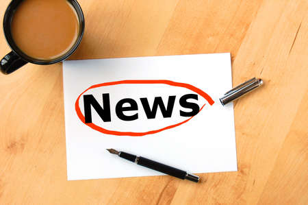 latest news concept with pen paper and coffee in business office photo