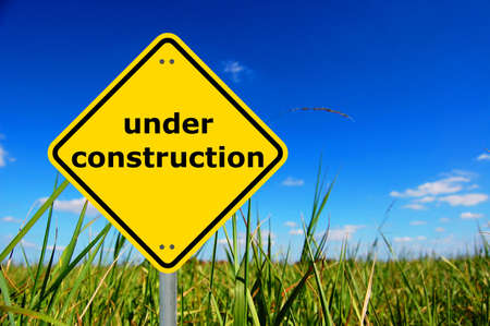 under construction sign and copyspace for a text message                                     photo