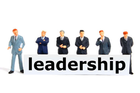 leadership or leader concept with business man and board isolated on white background photo