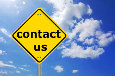 contact information: contact us written on a yellow road sign                                     Stock Photo