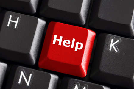 requesting: help support or assistance concept with red button on computer keyboard Stock Photo