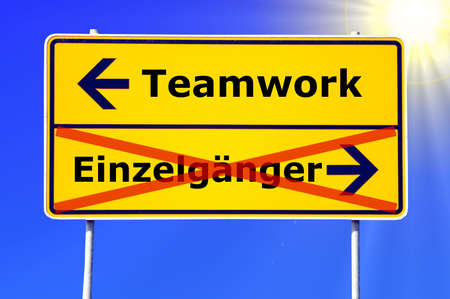 loner: team or teamwork concept with a german sign